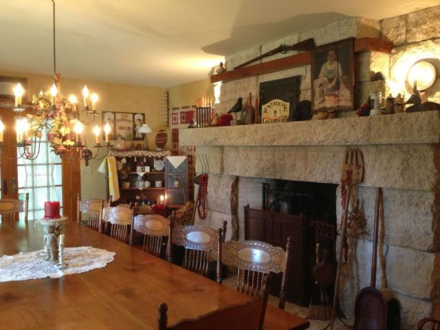 The B&B's dining room. The fireplace was built with limestone blocks from the foundation of the old farmhouse. The dining table was crafted from a walnut tree that grew on the property.